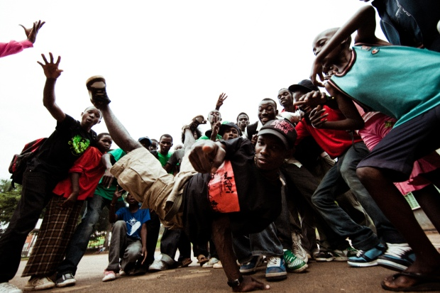 Abramz Tekya dances with children from Breakdance Project Uganda. Photograph provided by Nabil Elderkin, Bouncing Cats.