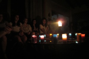 Candles lit for the closing reflection at the CIDCC. Photo by Kirsten Fenn