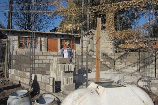 Foremen begin laying bricks for Juanita's house. Photo by Kirsten Fenn