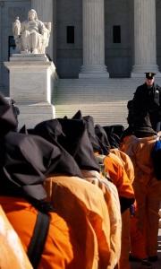 Protest to close Guantanamo, outside the U.S. Supreme Court. Photo by takomabibelot [CC-BY-2.0], via Wikimedia Commons.