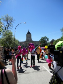 People march as part of the Winnipeg Pride Parade. Photo by Rachel Swatek