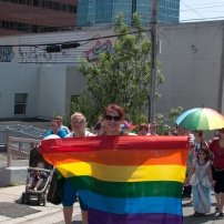 Many draped themselves in flags to show their pride through the streets of St. John's. Photo by Garrett Barry.