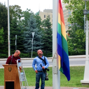Organizers prepare the podium and flag for the official Capital Pride flag ceremony. Photo by Kirsten Fenn