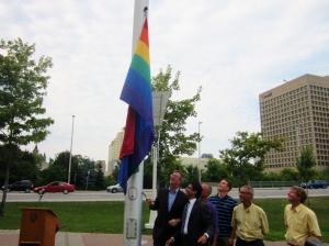 Ottawa Mayor Jim Watson and raises the rainbow flag to mark Capital Pride week. Photo by Kirsten Fenn
