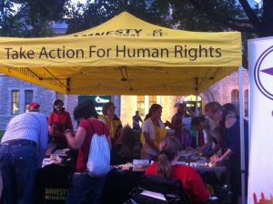 An information booth set up for participants and passersby of Amnesty International's Pride vigil. Photo by Brianna Harris