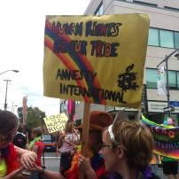 Amnesty International showing their pride. Photo by Brianna Harris