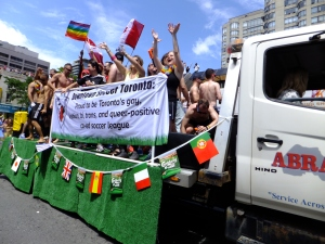 A GLBTQ soccer league float passes by in the Toronto Pride Parade. Photo by Caitlin Hart