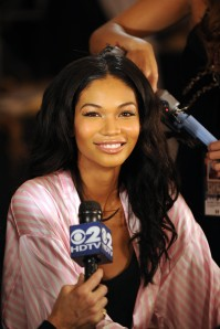 Model Chanel Iman has her hair and makeup done before the 2009 Victoria's Secret Fashion Show. Photo by Bryan Bedder/Wikimedia Commons