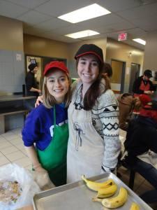 Nicole Vine (left) and I preparing dessert for the Shepherds of Good Hope lunch program.