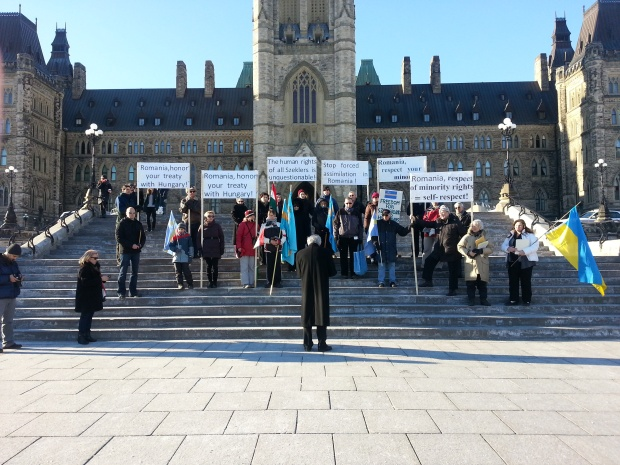 A small group of protesters stand outside Parliament Hill in support of Szekler Hungarians in Romania. Photo by Elizabeth Karchut