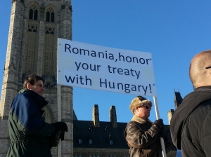 Protesters hold up a sign calling for Romania to honour their treaty with Hungary in which Romania would respect the minority rights of Hungarians. Photo by Elizabeth Karchut