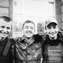 "Three friends (ages 20, 21 and 17 left to right) on Maidan. They have been on the square since the first day. When asked how long they intend on staying they replied, ""As long as it takes."""