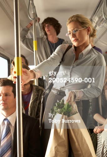 200524590-001-woman-carrying-shopping-bags-on-busy-bus-gettyimages